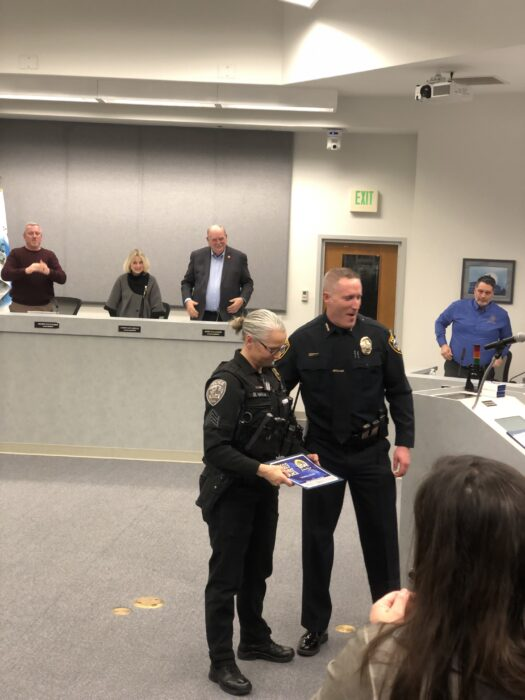 Port Orchard police officer Donna Main receiving the officer of the year award at a Port Orchard City Council meeting.