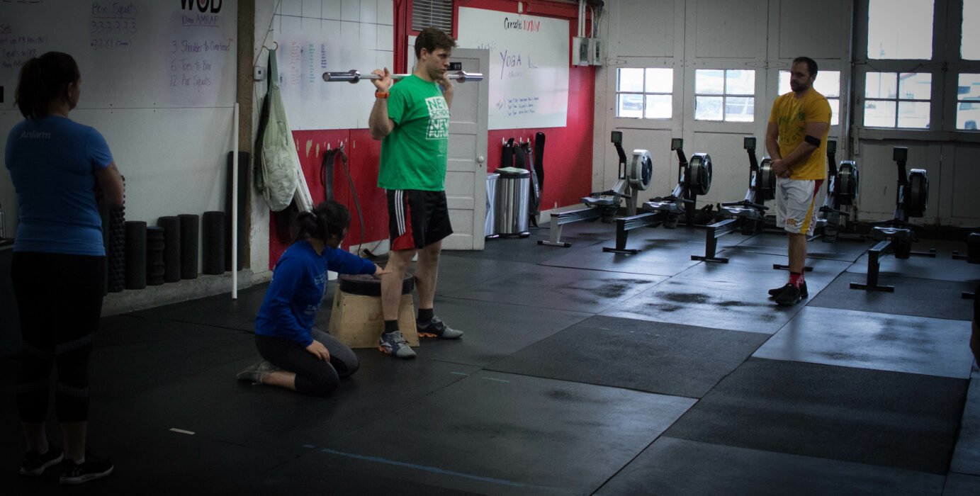 Coach Breezy coaching the box squat at our CrossFit gym in Port Orchard, Wa.